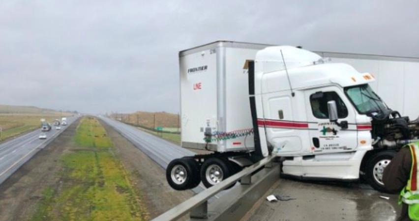 truck dangling on overpass